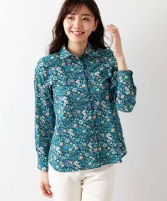 【リバティ】Rachel Meadowタナローンシャツ<br /><br />アマカ定番のLIBERTY柄のシャツです。今シーズンは優しい花柄にしました。<br /><br />柄は1988年にインテリア、ファブリック用に野花を描いたボタニカルデザインの新バージョンです。より多くの色を花に加える事により、花自体が際立つようなデザインです。<br />柔らかな肌触りと軽さ、豊かなドレープ性が特徴の素材です。<br /><br />モデル(下部ディテール画像):H 165 B 78 W 58 H 85 着用サイズ:38