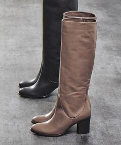 切り替えを少なくしとことんシンプルに仕上げたロングブーツ。<br>足首部分につけたジップで着用時にボトムスと整えられ、安定感のある太めのヒールで歩きやすさも。<br>ブラックは飽きずに履ける優秀カラー、レディに履いていただけるグレージュもおすすめです。<br><BR>
