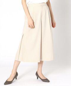 《素材》<br>リネンのようなさらりとした、ポリエステル糸を使用。<br>メランジ調に染め分け、さわやかな生地の表情を演出しました。<br>ポリエステルなので、リネンのようなシワを気にせず、<br>デイリーに着まわせます。<br>軽い素材感も魅力です。<br><br>《デザイン》<br>裾のサイドにボックスタックを入れ、動きを出したワイドパンツです。<br>ボックスプリーツで動くたびにタックが広がり、<br>エレガンスな印象に。<br>ウエストは後ろのみゴム仕様にして、<br>着心地の良さも考慮しました。<br><br>《セットアップ対応》<br>同素材のジャケット(商品番号:12-08GP08-200)<br>と合わせてセットアップとしてコーディネートしていただけます。