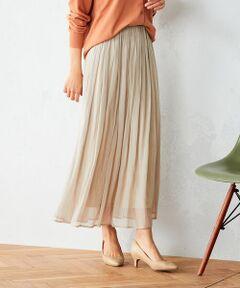 《素材》<br>しなやかさと、程よいハリ感を併せ持った風合いが特徴。<br>繊細な光沢感、シアー感が新鮮な、上品な素材感です。<br><br>《デザイン》<br>ウエストにギャザーをたっぷり入れた、ロングスカートです。<br>ウエストはゴム素材なので、履き心地の良さも特徴。<br>旬なシアー感と、光沢がスタイリングにアクセントをプラス。<br>カラーは合わせやすいベージュに加え、ポイントになるミントカラーと、<br>アッシュグレーの3色展開です。