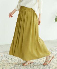 ◆ONIGIRI(おにぎり)のワッシャー加工 ギャザースカート◆<br><br>《素材》<br>軽くて柔らかな、レーヨン・ナイロン素材です。<br>落ち感のある風合いで、肌触りの良さにこだわりました。<br>生地には、ワッシャー加工を施し、ランダムなシワを出して表情のある素材に仕上げました。<br>また、素材の特性による控えめな光沢感があり、上品な印象です。<br><br>《デザイン》<br>落ち感のあるワッシャー素材で、スッキリとしたフォルムを演出。<br>ウエストは、一周総ゴム仕様になっているので、ストレスのない履き心地です。<br>また、ウエストに共地の紐が付いているので、ウエストサイズの調節ができます。<br>また、裏地がついているので、透ける心配がありません。