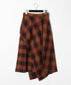 """立体感と動きのあるシルエットを生み出すアシンメトリーのイレギュラーシルエットが、モードな雰囲気を漂わせるスカート。<br />イタリア""""CANGIOLI""""(カンジョリ)社のウールをブレンドした素材を贅沢に使用した一品。<br />秋冬らしいシックな色合いでまとめたチェックパターンが、大人の女性のコーディネートに品良く溶け込みます。<br />シリーズでご用意したベストとセットアップでの着用が今季らしくてお勧め。<br />足元にブーツを添えたシーズンスタイルをぜひお楽しみください。<br /><br />同素材でお作りしたベルト付チェックベスト【品番:39457259】のご用意もございます。"""