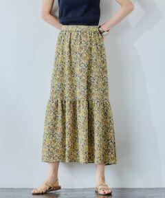 ◆穿いた瞬間に今っぽい空気を纏える!新作スカートをご紹介◆<br><br>ロング丈×やや低めの位置のシングルティアードが大人な雰囲気を演出する一着♪<br>ウエスト部分はバックゴム仕様でイージーな穿き心地ながら、サイドのファスナーできちんと感のあるデザインに仕上げました。<br><br>コーディネートに可愛げを添える洗練感のあるプリントにも注目。<br>すっきりとした腰回りから裾にかけてたっぷりと広がるボリューム感のバランスが絶妙です◎<br><br>主張しすぎない上品な華やかさをくれる一押しスカート。<br>デイリースタイルに活躍すること間違いなしです。<br><br>【POINT】<br>・フラットシューズとも相性抜群の長め丈<br>・綺麗に広がるフレアシルエット<br>・ドラマチックなティアードデザイン<br><br>こちらは同シリーズで無地(品番:3624-162-2156)もございます。<br><br>----------------------------------<br>透け感:なし<br>光沢感:なし<br>生地の伸び:なし<br>ケア方法:手洗い可・ドライクリーニング<br>裏地:あり<br>----------------------------------<br><br><font color=#008000>▼お気に入り登録のおすすめ▼<br>気になる商品は「お気に入り」登録がおすすめ!<br>お気に入り登録商品は、マイページにて現在の価格情報や在庫状況の確認が可能です。<br>お買い物リストの管理に♪是非ご利用下さい。</font> <br>#キレイメ#カジュアル#デイリー#フレア#Aライン#膝下#ミディ#ミモレ#半端#ロング#マキシ#丈#植物#柄<br><br><font color=purple>店舗へお問い合わせの際は、全国のgreen label relaxing各店舗まで下記の品名/品番をお申し付け下さい。<br>品名:FFC シングルティアードPRT SK  品番:3624-299-2157</font>