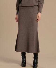 メリハリのあるシルエットが女性らしいニットスカートは、裾に向かって綺麗なフレアの出るマーメイドライン。動く度に揺れる裾が優雅な印象を与えてくれます。Super Zeaという特別なメリノ種の羊毛で仕立てており、カシミヤのような温もりとソフトな軽さがあるので穿き心地の良さも魅力です。単品使いは勿論のこと、同素材のニットを合わせればリラクシーなニットアップスタイルも楽しめるおすすめのスカートです。<br/><br/>・裏地なし<br/>・ウエストゴム仕様<br/><br/>セットアップ対応ドルマンニット品番:7104170523<br/><br/><br/>セットアップ対応ハイネックニット品番:7104170526<br/><br/><br/>■サンプル撮影商品■<br/>こちらの商品はサンプルでの撮影となっております。実際の商品とは、商品情報(生産国、色味、上代、納期など)が変更になる場合がございます。予めご了承ください。