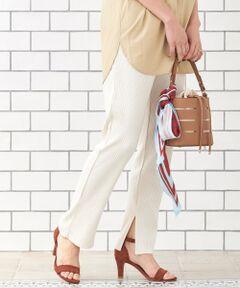 程よいハリがある伸縮性の生地とウエストゴムで、リラックスした履き心地のレギンスパンツ。<br>細めのリブと裾スリットですらりとした大人カジュアルな雰囲気と女性らしい抜け感を演出。<br>すっきりとしたシルエットでワンピースと合わせてもボリュームが出すぎず、きれいなスタイリングに仕上がります◎<br>手洗い可 ドライクリーニング可 陰干し<br>[ブラック]*摩擦や水濡れによる色移りにご注意下さい。