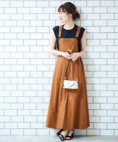 さりげなく配色ステッチのデザインがポイントのジャンパースカート。<br>やや光沢のある生地でカジュアルすぎずに決まります。<br>Tシャツはもちろん、ウエストはスッキリとしたシルエットなので<br>リブニットなどコンパクトなトップスと合わせるとより大人の女性らしくカジュアル過ぎずに着こなせるアイテム。<br>洗い可 ドライクリーニング可 陰干し<br>*製品洗いを施している為、一点一点について若干風合い・サイズが異なりますがご了承下さい。<br>*摩擦や水濡れによる色落ち・色移りにご注意下さい。