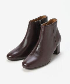【秋冬コーデに欠かせないショートブーツ】<br><br>2006年にパリ在中フランス人デザイナーの<br>MARION TOUFET氏によって設立されたブランド。<br><br>全てはポルトガル製で厳選された革と素材を<br>使用し、シックで都会的、さらに随所に<br>フレンチの香りを残した履き心地の良い<br>靴づくりを心掛けています。<br><br>秋冬スタイルに欠かせないショートブーツは<br>ヒールの太さも高さもちょうど良く、安定感の<br>ある履き心地を実現。<br>*この製品は天然皮革を使用しております。<br>*摩擦や水濡れによる色落ち・傷・硬化にご注意下さい。<br>*素材感と雰囲気を重視した加工の為、色の濃淡やシワの入り方など一点一点の表情にバラつきやムラがございますのでご了承下さい。<br>*インポート製品の特性上、キズ・汚れ・色ムラが見られる場合がありますのでご了承下さい。
