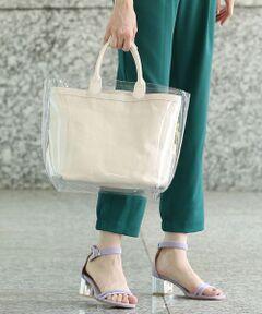 今シーズントレンド素材のPVCを使用したビニールバッグ。<br>小ぶりでも、マチを広くしたトートは見た目以上に荷物が入ります。<br>雨の日にでも気軽に持てるところもポイント。<br>インバッグは持ち手仕様になっていますので、キャンバスバッグ単体としても使用できます。<br>PVC素材なので、雨の日でも気軽に持てるバッグとしてお勧めです。梅雨時期にはマストなアイテム♪<br><br><br>※画像の商品はサンプルです。<br> 実際の商品と仕様、加工、サイズが若干異なる場合がございます。<br><br>ROPE'の商品は、ROPE'実店舗のみの取り扱いになります。<br>また、ROPE' mademoiselle の商品は、ROPE' mademoiselle実店舗のみの取り扱いになります。