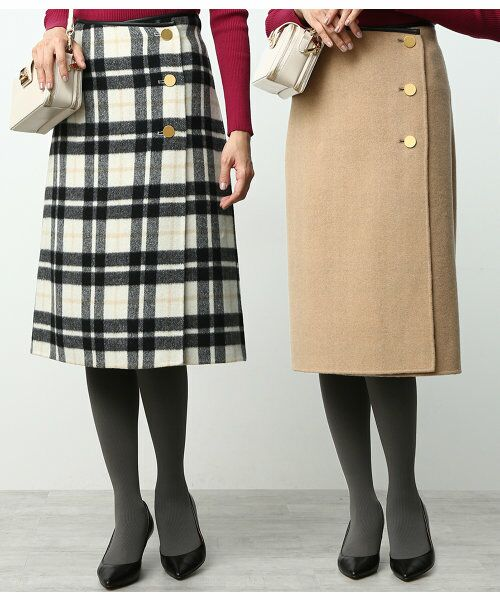 ウール先染めの産地である尾州で織り上げた素材を使用した毎年大好評のリバーシブルスカートに今年はミディ丈が初登場!