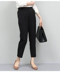 <b>履き心地の良さが魅力。セットアップとしてもおすすめのパンツ。</b></br></br>日本の大手繊維商社ユニチカの開発糸NOIE(ノイエ)のストレッチ素材を使用したスカート。シルキーで上品な光沢、ドレープ性やきしみ、軽さが特徴でストレッチ性に優れ、着心地の良さが魅力です。<br>裾に向かって広がる美しいドレープのフレアシルエットが女性らしく、歩くたびに華やかに揺れます。ウエスト部分はすっきりとさせ、付属のベルトでウエストマークしてスタイルアップ効果も抜群◎程よいミディ丈で今年らしく大人っぽく着こなせるスカートです。オフィススタイルやきちんとしたシーンにもおすすめ。同素材のテーラードジャケット(GGV29220)やノーカラージャケット(GGV29210)、テーパードパンツ(GGS29220)を展開中。セットアップでの着こなしもおすすめです。<br><br>※室外で撮影している画像は、光の影響で色味が若干異なって見える場合がございます。  <br><br>ROPE'の商品は、ROPE'実店舗のみの取り扱いになります。<br>また、ROPE' mademoiselle の商品は、ROPE' mademoiselle実店舗のみの取り扱いになります。</br></br>手洗い・漂白、タンブル乾燥禁止