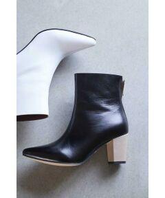すっきりとしたデザインで大人っぽい足元に決まるブーツ<br/>・日本人の足に合わせたpiu comodaだけの木型を使用<br/>・安定感のあるチャンキーヒール<br/>・フィット感をサポートしてくれるクッションが入ったインソール<br/>・つま先部分がきつくなりにくいように調整されたポインテッドトゥ<br/>・履き心地を良くし、汚れが目立ちにくいマイクロファイバーインソールを使用<br/><br/><br/>【スタッフレビュー】<br/>少し長めの丈感が今期らしいブーツ。ロングスカートから素足が見えないような足首がしっかりと隠れる長さで、旬のスタイリングを楽しめる1足です。バイカラーでポイントにもなるヒールは安定感があり、スタイルアップ効果も◎。トレンドのパイソン柄に加え、ツヤ感のあるブラック、ポイントになるホワイトのクールなカラー展開でコーディネートを引き締めてくれます。