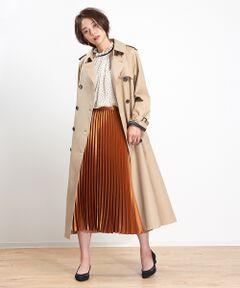 ラグランスリーブが今年らしい雰囲気のトレンチコート。<br>定番のロング丈トレンチコートをラフなシルエットにアップデートしました。<br>大人っぽく着られるゆったりしたフォルムが魅力の一着。<br>取り外し可能なライナー付き。ライナーはチェック柄でトレンドもさりげなく取り入れました。<br>model:H166・B80・W59・H86 着用サイズ:36<BR>