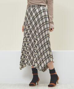 コットンライクなポリエステル素材を使用した、イレギュラーヘムのチェック柄プリーツスカート。<br>細かくプリーツが入っているので、ボリュームが出すぎず大人な印象に。<br>秋カラーなので一枚で旬顔スタイルが完成。<br>秋はTシャツやカットソーと、冬はニットやスウェットと合わせても◎<br>同シリーズのシャツ(NO,31390010007)とのセットアップスタイルもおすすめです。<br><br>ベージュ モデル:H166 B80 W58 H82 着用サイズ:36<br>ネイビー モデル:H165 B80 W58 H85 着用サイズ:36<br><BR>