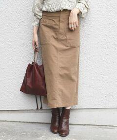 ウエストとフロントポケットを飾るゴールドのスタッズが、さりげないアクセントになったベイカースカート。<br>ボディラインに優しく沿う長めのレングスは、バックにスリットをあしらい、細身のシルエットながら足さばきが良いのも魅力です。<br>すっきりとしたIラインがスタイルを美しく見せてくれます。<br>ニットなどを合わせたカジュアルコーデはもちろん、キレイめなスタイリングにもマッチします。<br>フロントはファスナー開きです。<br><br><br>※末永く愛用頂く為に、アテンションタグ・洗濯ネームを必ずご確認の上、着用又はお取り扱い下さい。<br>
