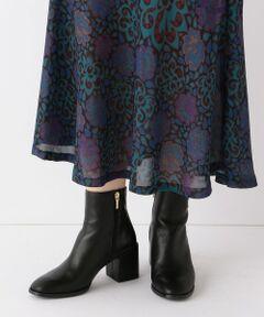 【MARIAN】ショートブーツ。<br>シンプルなフォルムで、パンツにもスカートにも合わせられるショートブーツ。<br>サイドジップで脱ぎ履きしやすいデザイン。<br><br>【テザインポイント】<br>女性らしいエレガントで高級感漂う仕上がりです。<br>つま先は、ややスクエアでスタイリッシュな雰囲気に。<br>ヒールは高めですが、太めなので安定感があり歩きやすいのも魅力。<br><br>【コーディネート・その他】<br>スカートにもパンツにも◎<br>バランスのとりやすい絶妙なショート丈なので、<br>ボトムス選びに悩まない点もおすすめのポイントです。<br><br>【MARIAN】(マリアン)<br>スペインのファクトリーブランドMARIAN。<br>生産管理者が最新技術を取り入れながら、トレンド感のあるデザインと品質の両方を兼ねそろえたシューズ作りを心掛けています。<br><br><br>※生産過程に生じるキズが多少ある場合がございます。また素材の特性上、若干の色ムラ、擦れが見られる場合がございますが、予めご了承下さい。<br>※薄いボール紙を使用した箱の為、輸送中に箱が多少破損する場合がございます。予めご了承お願いいたします。<br>※サイズ換算(表記)はあくまで目安となります。<br>※末永く愛用頂く為に、アテンションタグ・洗濯ネームを必ずご確認の上、着用又はお取り扱い下さい。<br><br>※画像の商品はサンプルです。 <br>実際の商品と仕様、加工、サイズが若干異なる場合がございます。
