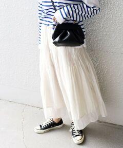 """程よく透け感のある素材にワッシャープリーツをかけたエアリーなスカート。<br>ウエストはゴム仕様になっているのでストレスフリーで履いて頂けます。<br>ワッシャープリーツ加工を施しているので、シワも目立たずイージーケアなのも嬉しいポイント。<br>控えめな光沢感がきれいめコーディネートにも活躍してくれます。<br><br>-------------------------------------<br>生地の厚み:薄手<br>伸縮性:無<br>透け感:有(裏地付き)<br>光沢感:やや有<br>水洗い:可<br>-------------------------------------<br>【スタッフ着用コメント】<br>《スタッフ1》<br>身長:156cm/体型:細身/普段サイズ:36/着用サイズ:ONE SIZE<br>サイズ感:ウエストがゴムになっているので締め付けがなく楽な着心地でした。スカートの丈はくるぶしが見えるぐらいの長さです。<br>コメント:エアリー感がある素材なので、動いた時の裾の揺れが綺麗でした。柔らかいカラー展開なのではっきりしたカラーのトップスと合わせてもバランス良く着こなせます。春先はローカット・ハイカットのスニーカーで季節に合わせたスタイリングを楽しめそうです。<br>-------------------------------------<br><br><br>※末永く愛用頂く為に、アテンションタグを必ずご確認の上、着用又はお取り扱い下さい。<br>※しわ、プリーツ加工は、永久的なものではありません。<br>※着用、洗濯の繰り返しで、しわ、プリーツは徐々に消失していきます。<br>※シワ加工、プリーツ加工の再加工はできません。<br>※屋外での撮影画像は、光の当たり具合で色味が異なって見える場合があります。商品の色味は、スタジオでの詳細画像をご参照ください。<br><br><font color=""""RED"""">※画像の商品はサンプルです。 </font><br>実際の商品と仕様、加工、サイズが若干異なる場合がございます。</p>"""