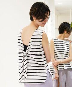 さらりとしたタッチと自然な光沢感が魅力の、コットンジャージー素材を使用したシリーズ。<br>バックリボンプルオーバーはノースリーブにきゅっと詰まったネックラインでミニマルなフロントに対し、大胆に開いたバックコンシャスなデザインで女性らしい抜け感のある一着です。<br>やや幅広のショルダーで一枚で着用しやすいのもポイント。<br>大胆な前後差のあるヘムラインでタックイン・アウトどちらの着こなしもバランス良く着用いただけます。<br>コーディネートに新鮮な表情をプラスしてくれるアイテム。<br><br>2019SS商品<br><br><b>店舗にお問い合わせの際は、下記の品番をお申し付けください。<br>品番:12039103707</b>