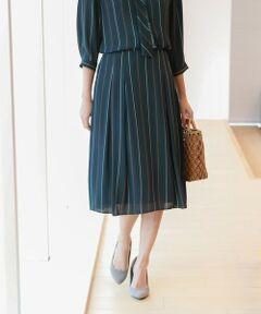 【ウォッシャブル】ストライプジョーゼットスカート<br /><br />フロント、バック共にタックを入れたミディレングスのスカートです。様々なトップスに合わせやすいシンプルなデザインスカートになっています。同素材のブラウス(U1M33-383)と合わせてドレス風の着こなしもおすすめです。<br />細番手のポリエステルを二重にして織り、薄い生地ながら適度なハリ感を表現しています。強撚糸によるシャリ感が特長の素材です。<br /><br />【着用推奨シーズン】春〜秋<br /><br />モデル(下部ディテール画像):H 170 B 78 W 58 H 84 着用サイズ:38